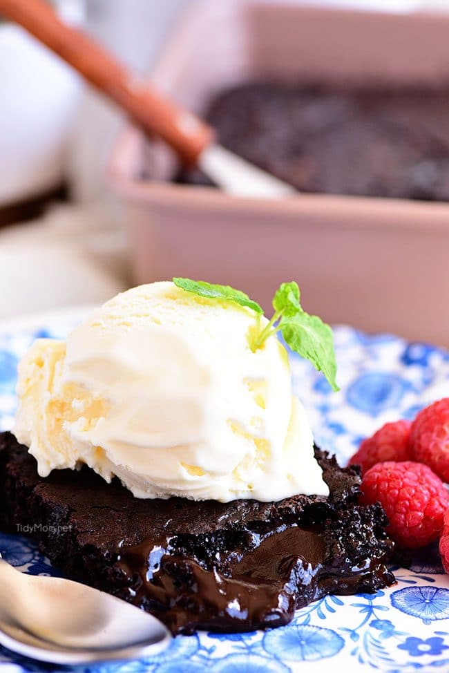 chocolate lava cake on a plate topped with ice cream