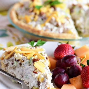Pineapple Chicken Salad pie on plate with fruit
