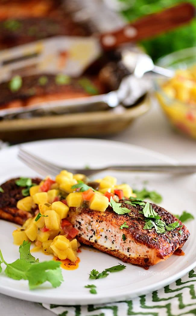 blackened salmon with mango salsa on a white plate