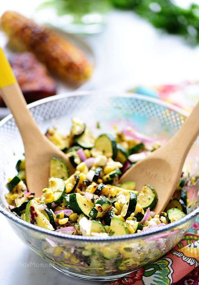 Fresh grilled corn and zucchini salad in a glass bowl