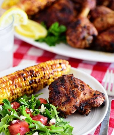 plate of easy lemon herb grilled chicken corn and salad