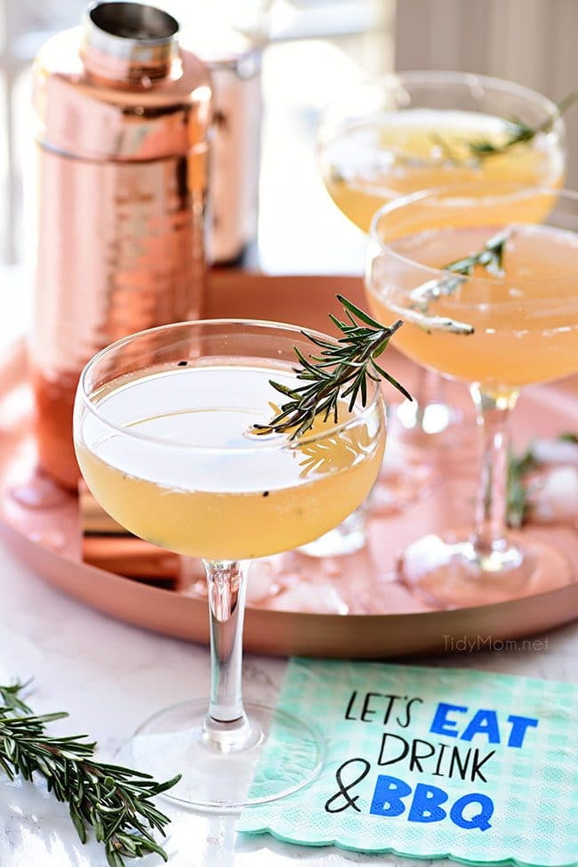 Tray of Bourbon Sour cocktails with smoked rosemary