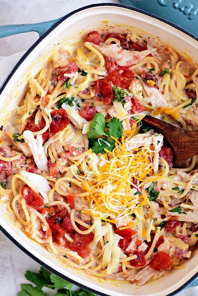 close up of Creamy One-Pot Chicken Spaghetti in a dutch oven