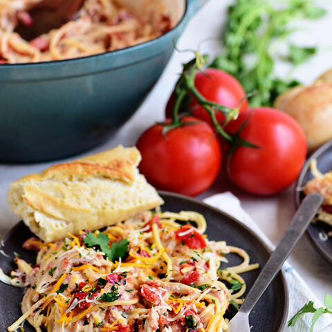 Creamy One-Pot Chicken Spaghetti on a plate with french bread