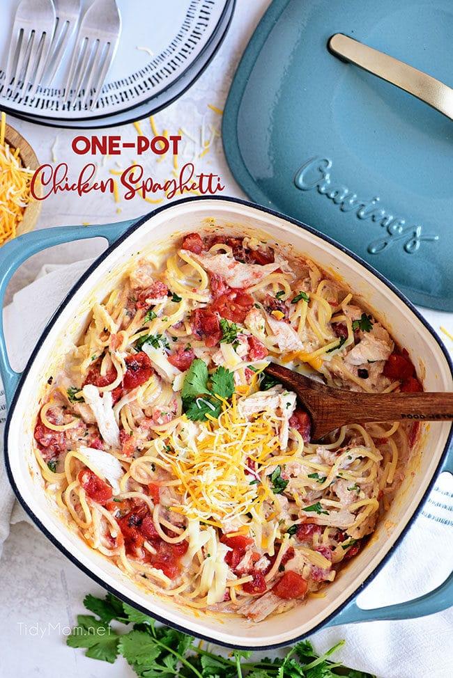 Creamy One-Pot Chicken Spaghetti in a blue dutch oven