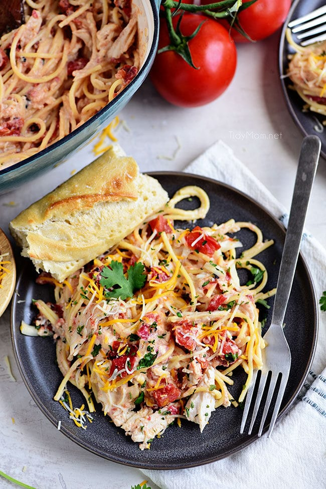 Creamy One-Pot Chicken Spaghetti on a gray plate with french bread
