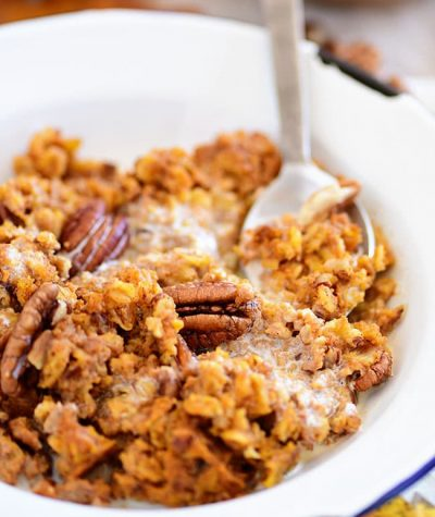 baked pumpkin oatmeal in a bowl with a spoon