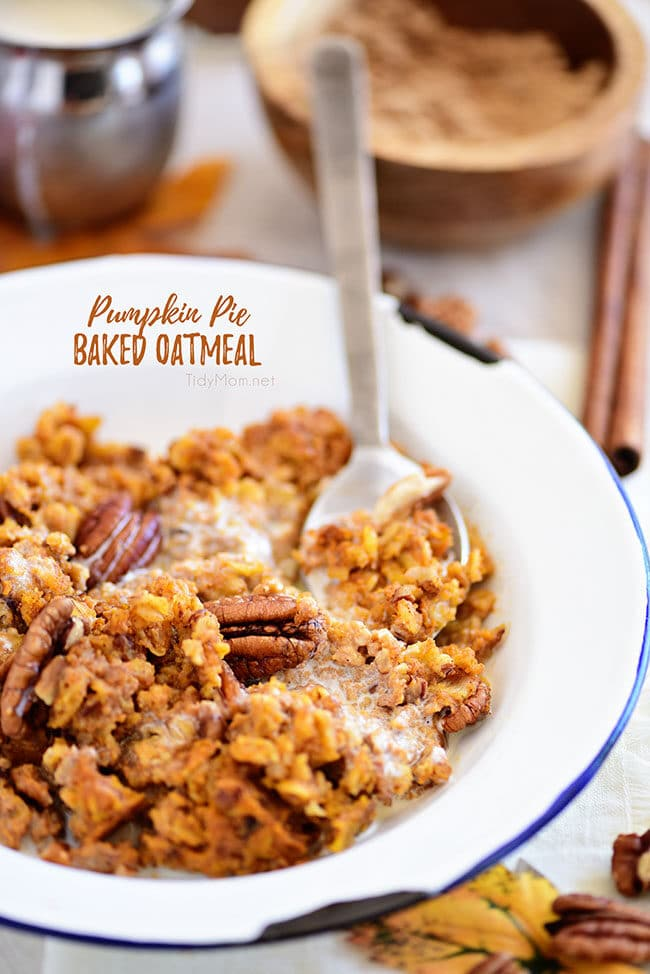baked pumpkin oatmeal with pecans in a bowl with a spoon