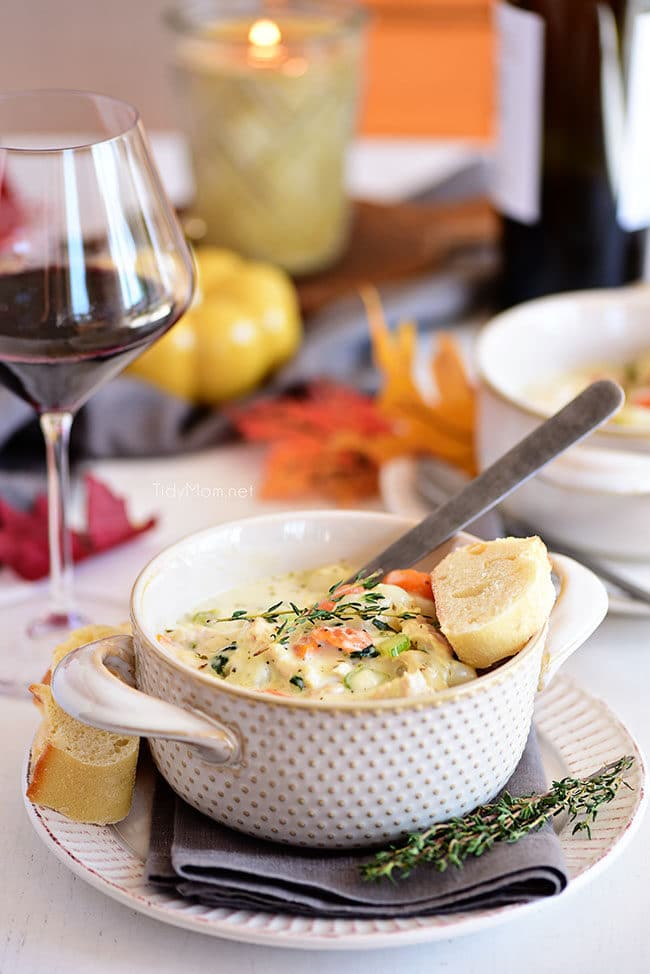 A bowl of creamy chicken gnocchi soup on a dinner table