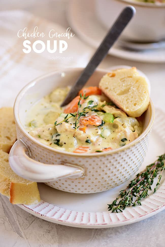a bowl of creamy chicken gnocchi soup with a slice of bread