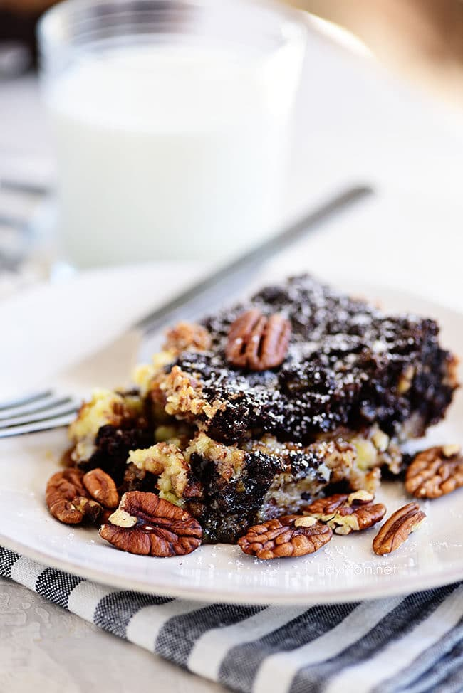 Chocolate Pecan Pie Gooey Butter Cake on a white plate