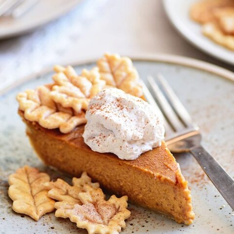 pumpkin pie with leaf cut-outs