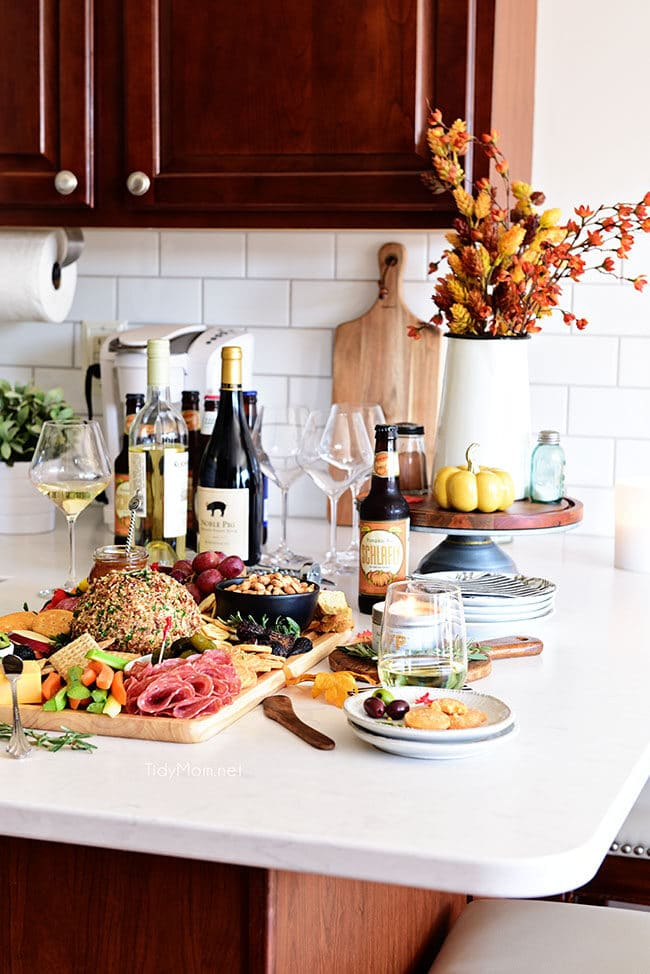 Fall Charcuterie Board on kitchen counter with wine