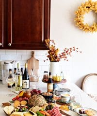 Fall Charcuterie Board in white kitchen with wine