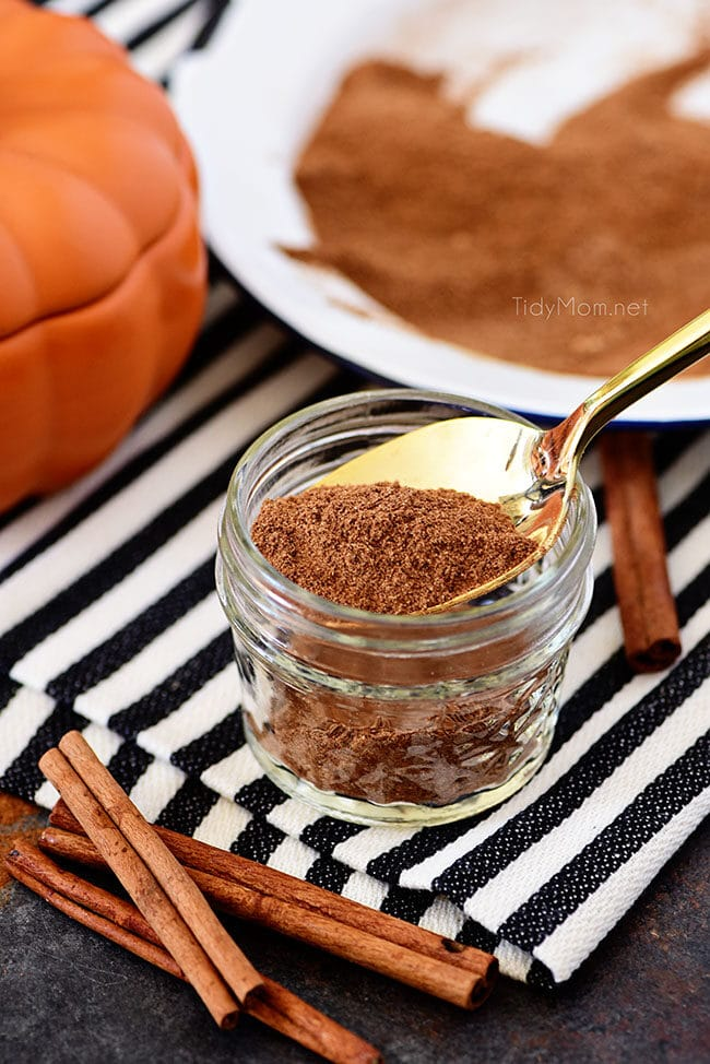 homemade pumpkin pie spice in a jar with a gold spoon