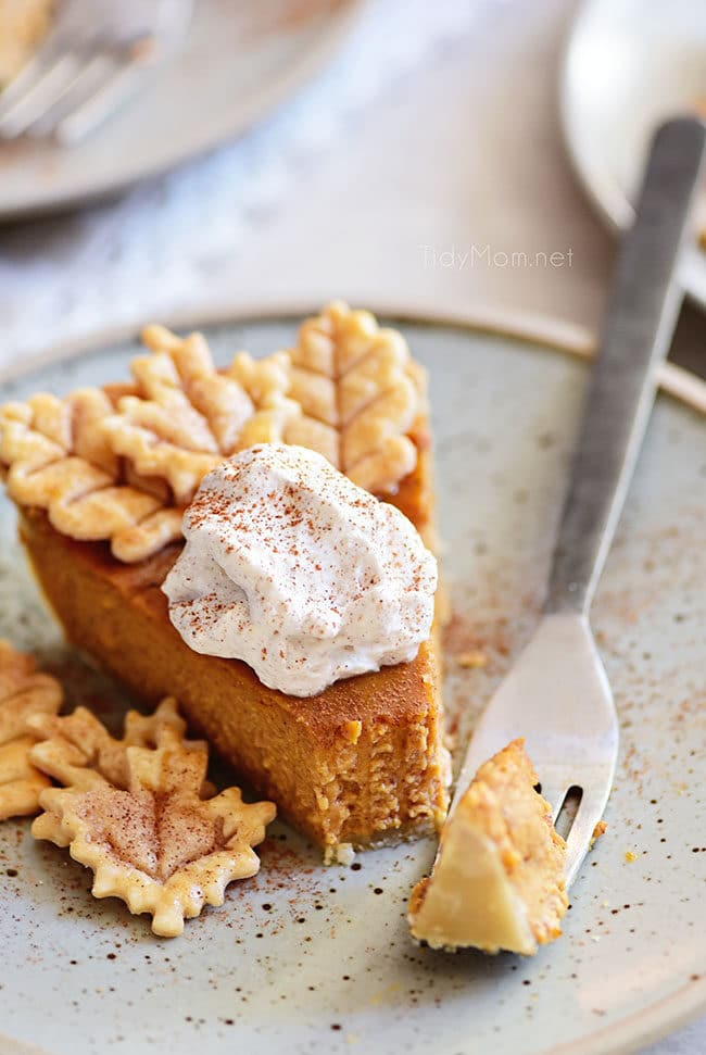 pumpkin pie with a bit take out on fork