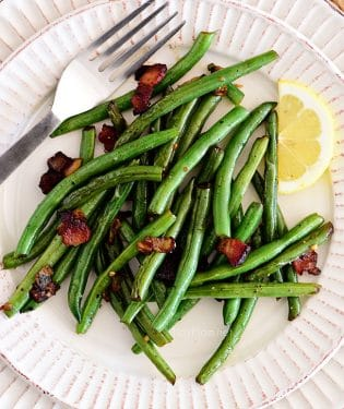 Sautéed Green Beans with bacon and lemon on a plate