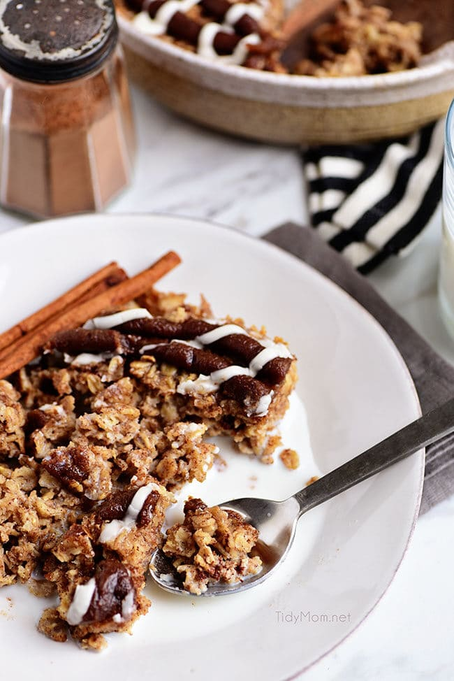 bowl of Cinnamon Roll Baked Oatmeal with milk