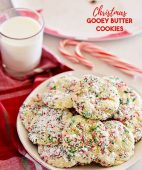 Christmas Gooey Butter Cookies on a plate with a glass of milk