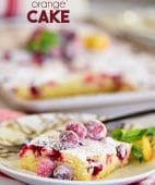 a piece of Super moist Cranberry Orange Cake topped with sugared cranberries