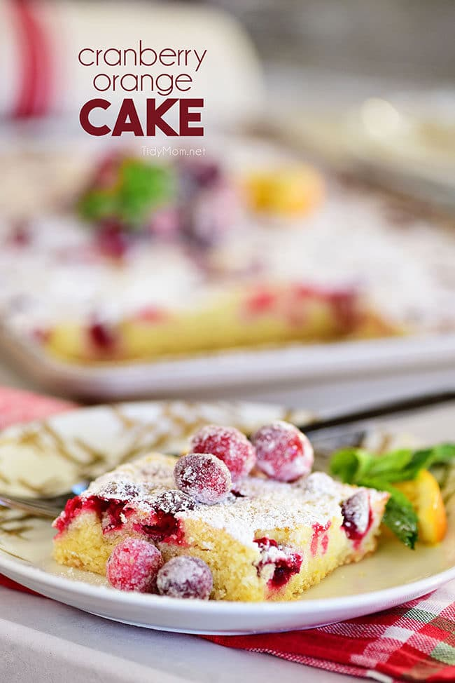 a piece of Super moistCranberry Orange Cake topped with sugared cranberries