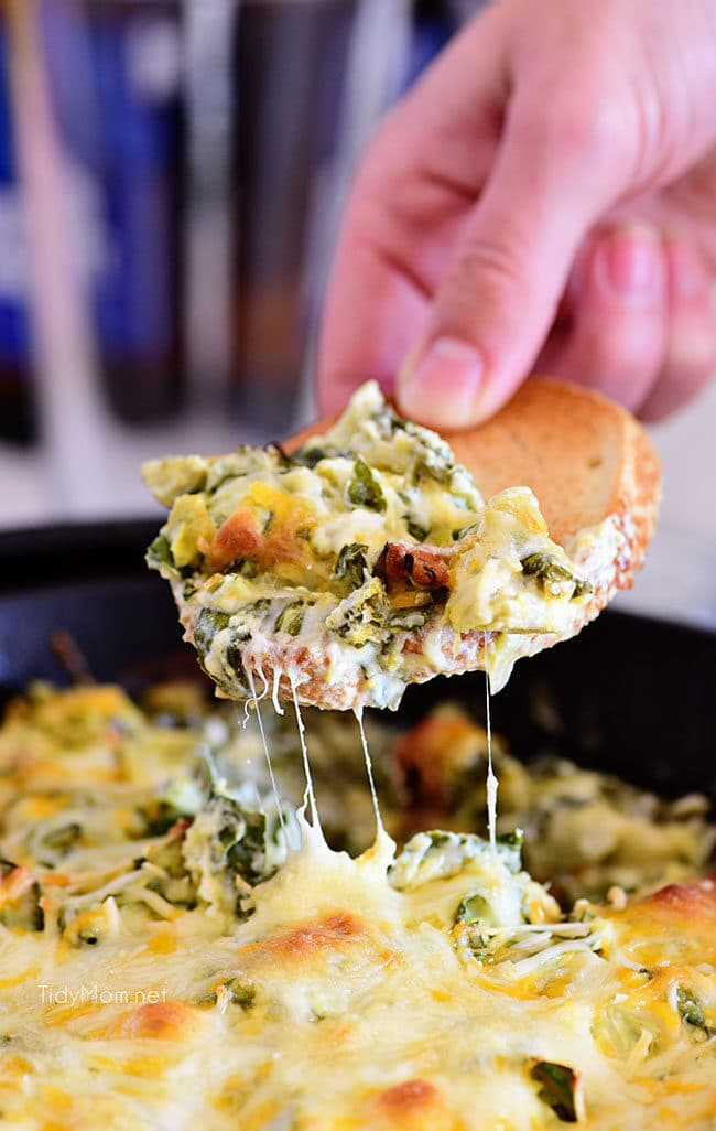 hot cheesy Spinach Artichoke Dip on toasted baguette