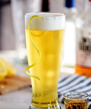 boilermaker beer cocktail with a lemon twist in a frosty glass