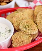 delicious fried pickles in a red basket