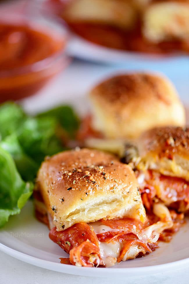 three pepperoni Pizza Sliders on a plate