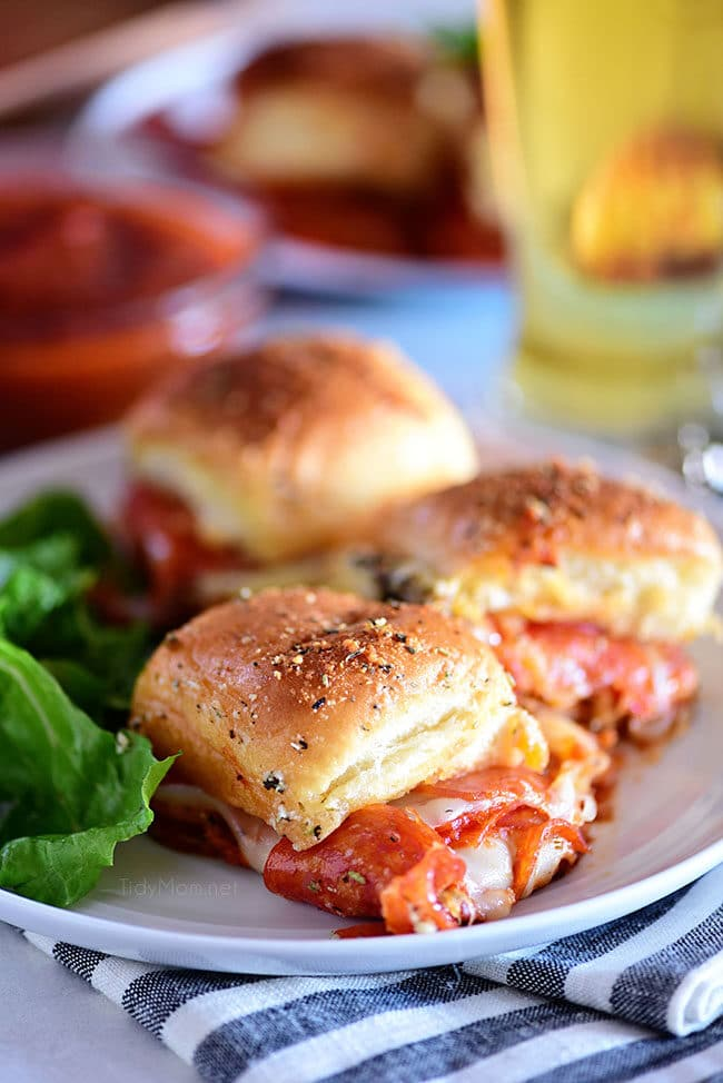 three cheesy pepperoni Pizza Sliders on a plate