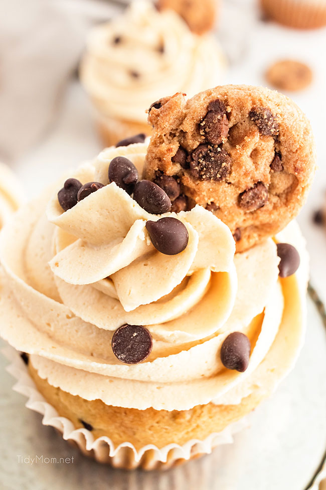 Cookie Dough Cupcakes with Cookie Dough Frosting with a tiny chocolate chip cookie on top