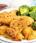 chicken tenders on a plate with broccoli