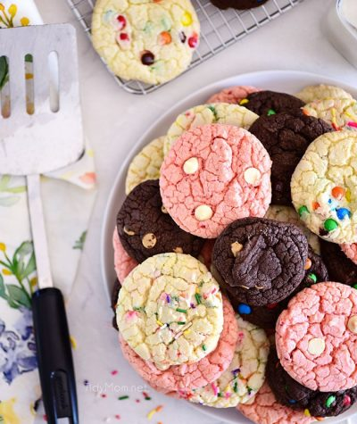 chocolate, vanilla and strawberry cookies stacked on plate