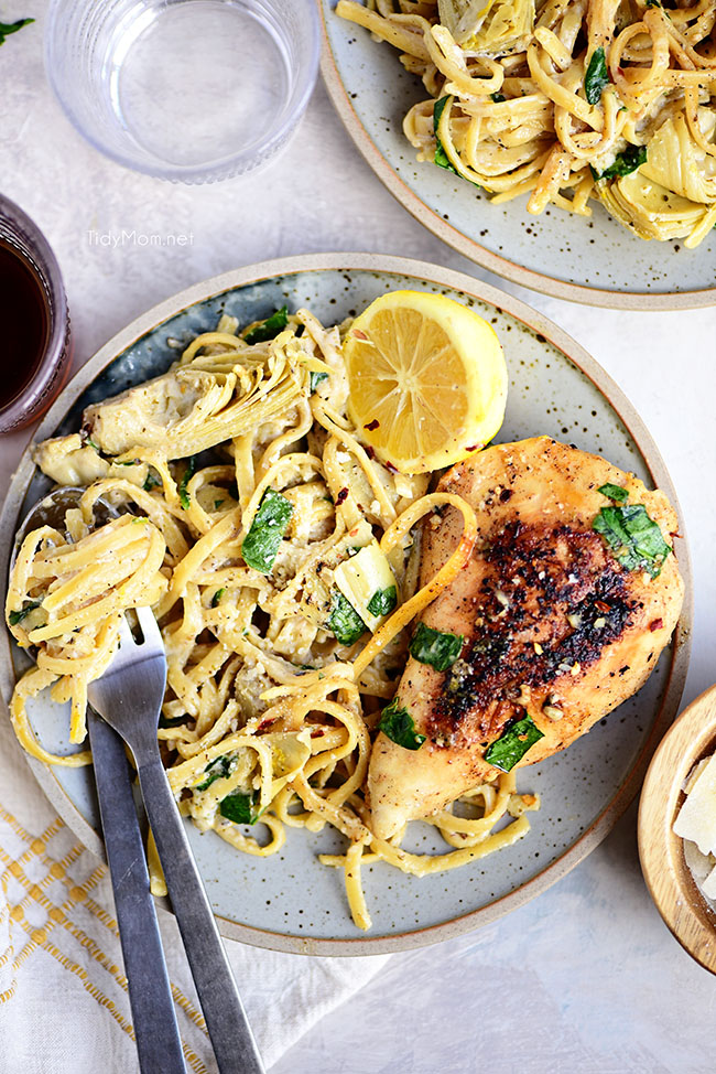 lemon artichoke pasta with a chicken breast on a plate