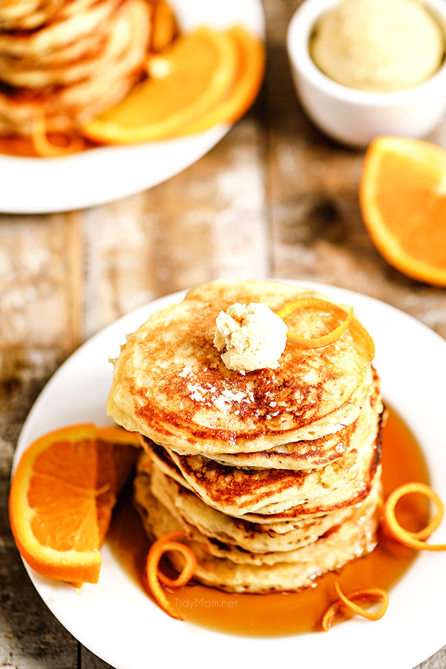 stack of orang pancakes on a plate