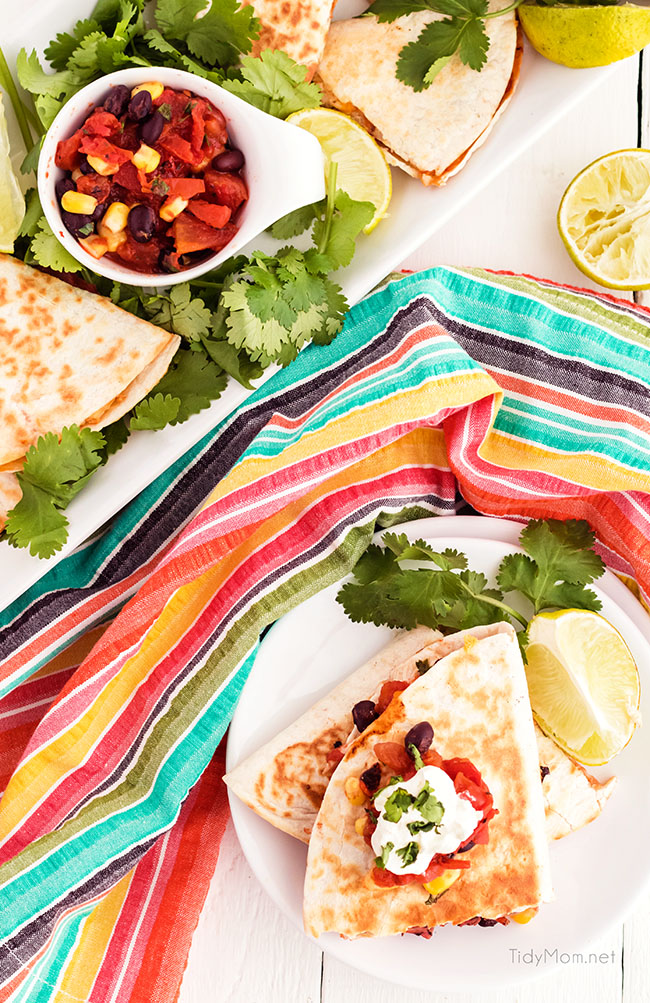 chicken quesadillas on a plate with colorful napkin