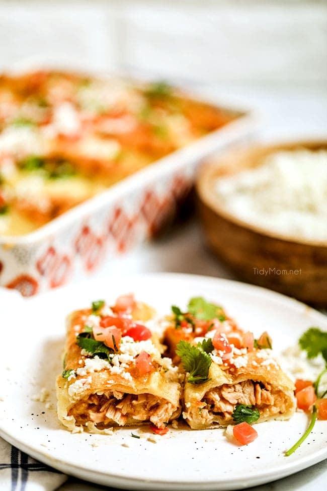 cheesy enchiladas on a plate