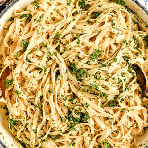 close up of fettuccine alfredo in a pot