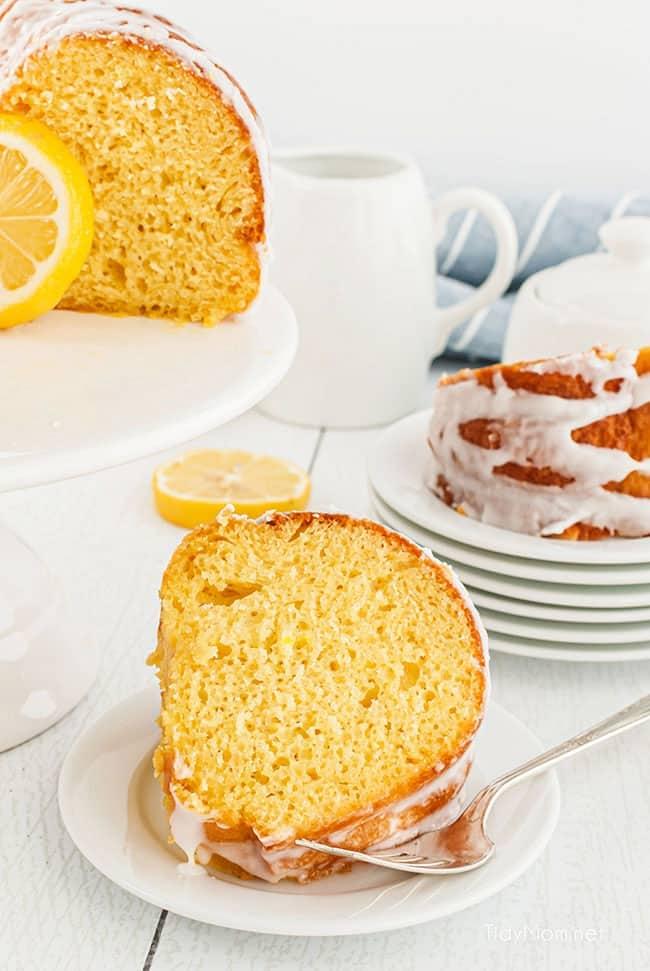 lemon cake sliced and big slice on a plate