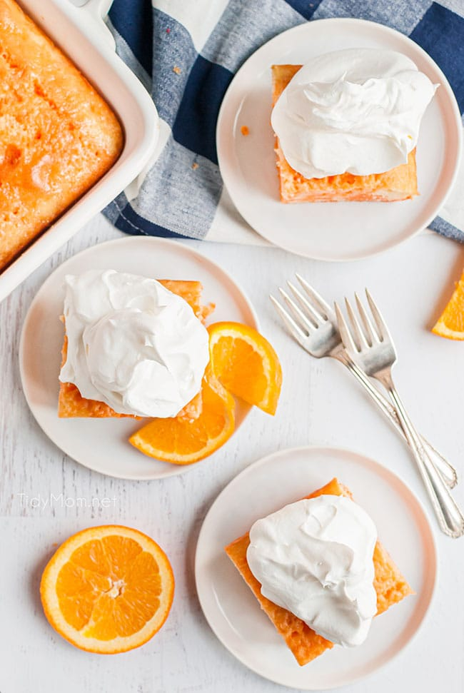 orange jello cake on white plates with orange slices