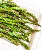 white plate with parmesan roasted asparagus