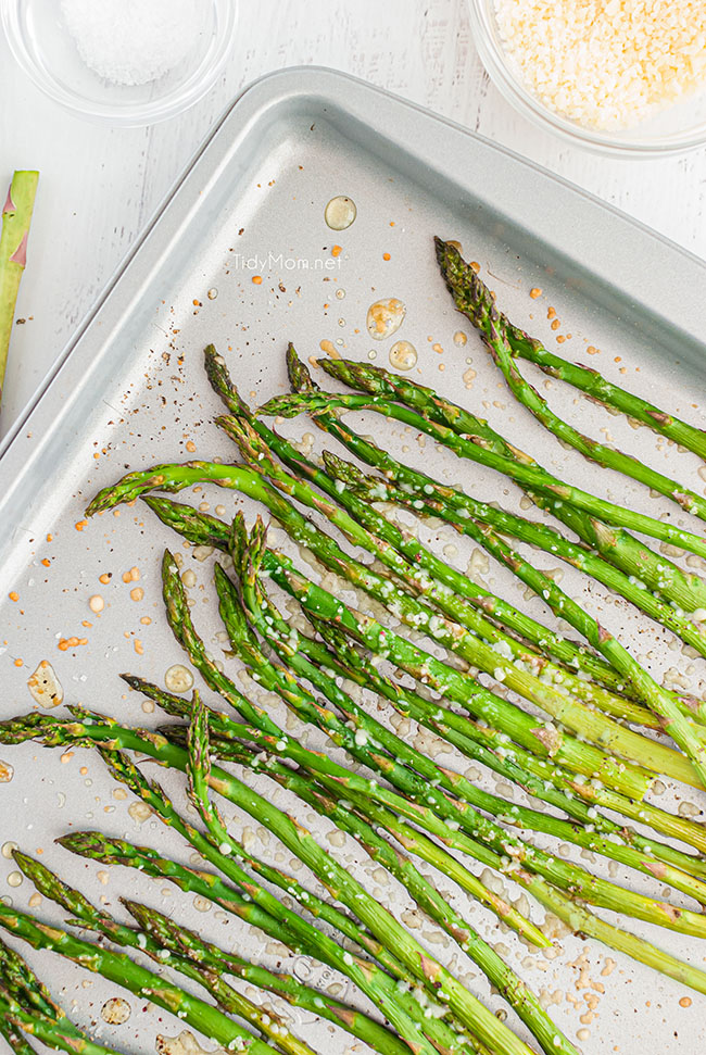 cooked asparagus on a baking sheet