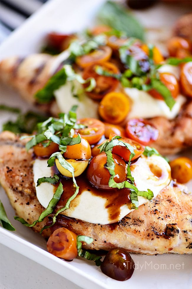 grilled chicken breasts topped with caprese salad