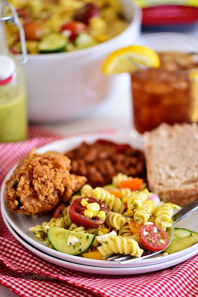 Summer pasta salad on a plate with fried chicken