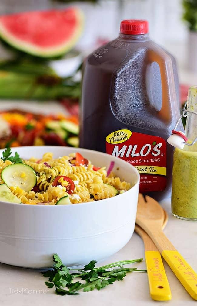 summer pasta salad next to a jug of sweet tea