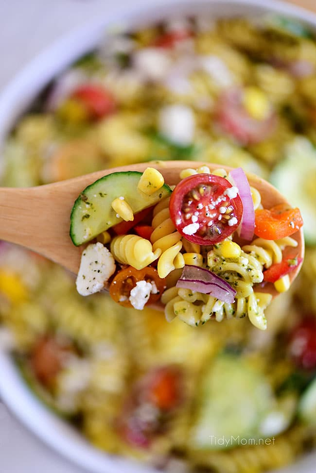 overhead shot of summer pasta salad on a spoon