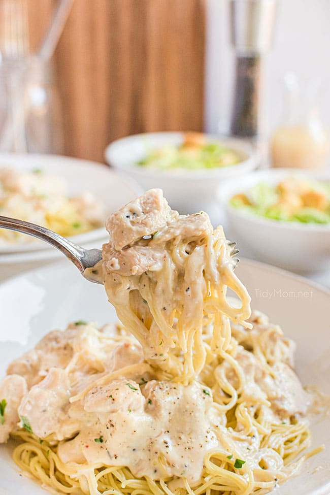 creamy chicken and pasta on a fork