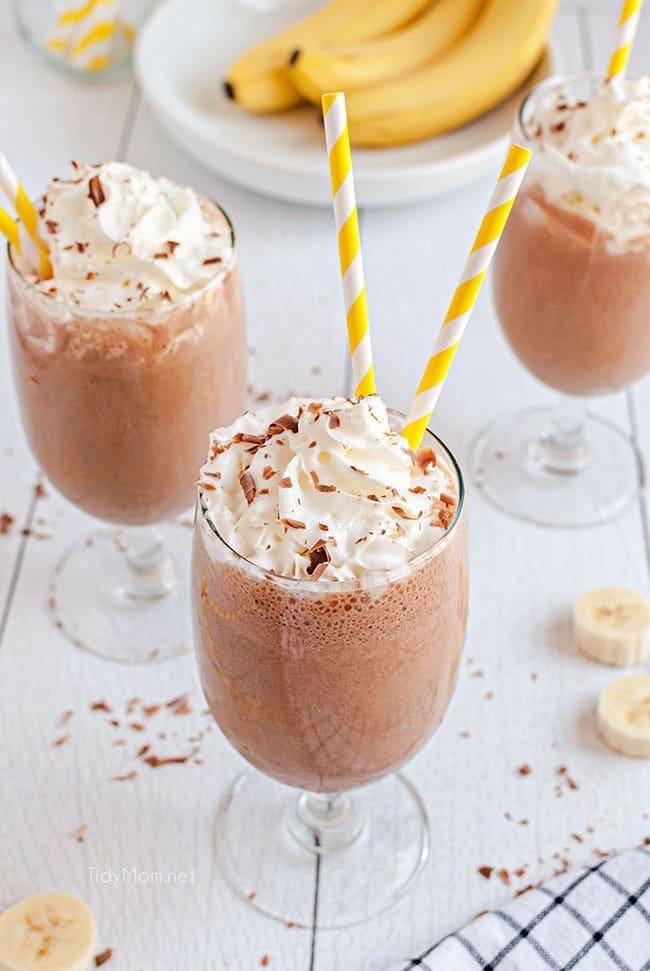 milkshakes with whipped cream and yellow straws