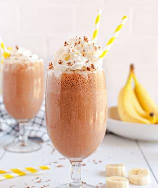 milkshakes with yellow straws and bananas
