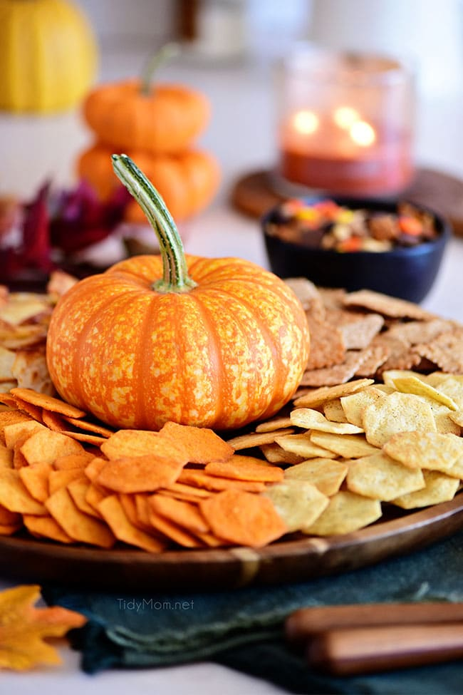 round tray with chips and a pumpkin